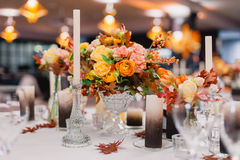 The elegant wedding table. Wedding table that decorated with flower arrangements and candles Royalty Free Stock Photography