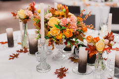 The elegant wedding table. Wedding table that decorated with flower arrangements and candles Royalty Free Stock Photo