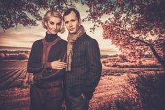 Elegant well-dressed couple outdoors Stock Image