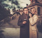 Elegant well-dressed couple outdoors Royalty Free Stock Photos