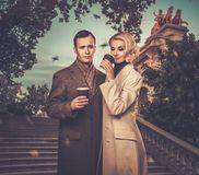 Elegant well-dressed couple outdoors Royalty Free Stock Images
