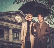 Elegant well-dressed couple outdoors stock images