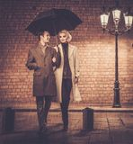 Elegant well-dressed couple outdoors Royalty Free Stock Photo