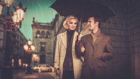 Elegant well-dressed couple outdoors Stock Photography
