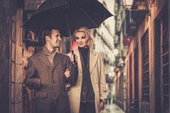 Elegant well-dressed couple outdoors Stock Image