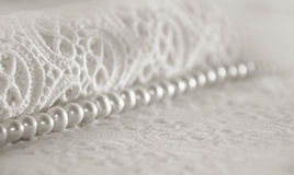 Elegant white background with lace, silk and pearls Stock Images
