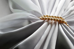 Elegant white background with silk and pearl Royalty Free Stock Photography