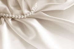 Elegant white background with silk and pearl Royalty Free Stock Photo