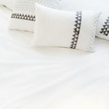 Elegant white bed linen with pillows Royalty Free Stock Photos