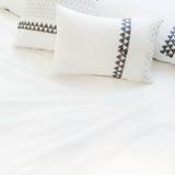 Elegant white bed linen with pillows Royalty Free Stock Photos