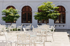 Elegant White Cafe Tables and Chairs Royalty Free Stock Image