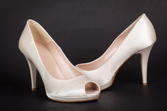 Elegant white female shoes on dark background Royalty Free Stock Photo