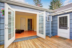 Elegant white glass doors leading to back deck. Stock Photography
