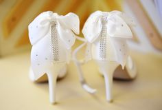 Elegant white wedding shoes Stock Photo