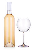 Elegant white wine glass and bottle isolated Stock Images