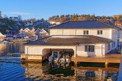 Elegant white wooden garage for luxury boats Stock Image