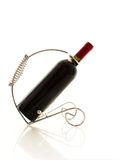 Elegant wine stand. Red wine bottle in an elegant wine stand reflected Stock Photo
