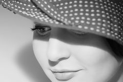 Elegant woman. In hat with charming smile closeup portrait. Black and white Royalty Free Stock Photo