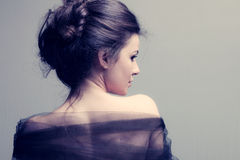 Elegant woman. With bun, back view profile, studio shot stock images