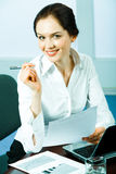 Elegant woman. Young elegant business woman holding paper and pen Stock Images