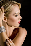 Elegant woman. Gorgeous woman wearing a diamond bracelet royalty free stock photography