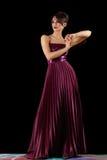 Elegant woman against  dark wall Royalty Free Stock Photo
