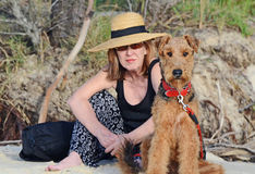 Elegant woman & Airedale Terrier dog on vacation Royalty Free Stock Photos