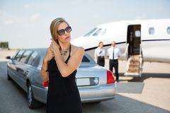 Elegant Woman At Airport Terminal Stock Images