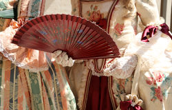 Elegant woman with an ancient ceremonial dress and the fan in he. Elegant woman with an ancient ceremonial dress and the fan  with white glove Stock Image