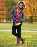 Elegant woman in autumn scenery Stock Images