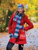Elegant woman in autumn scenery Stock Photography