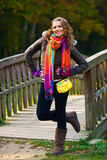 Elegant woman in autumn scenery Royalty Free Stock Photo