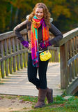 Elegant woman in autumn scenery Stock Photo