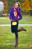 Elegant woman in autumn scenery Royalty Free Stock Image