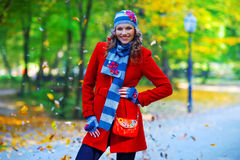 Elegant woman in autumn scenery Stock Image