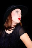 Elegant woman in balck dress and hat Royalty Free Stock Photos