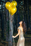 Elegant woman with balloons in forest Royalty Free Stock Image