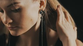 Elegant woman with beautiful earrings. Close up stock footage