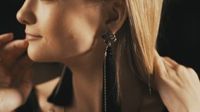 Elegant woman with beautiful earrings. Close up stock video footage