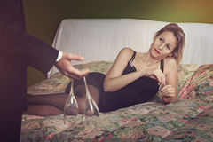 Elegant woman on bed ready to toast Royalty Free Stock Images