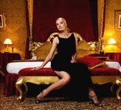 Elegant woman in bedroom Stock Image