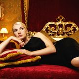 Elegant woman in bedroom Stock Images