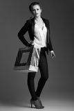 Elegant woman with big shopping bag against grey background Royalty Free Stock Photo