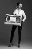 Elegant woman with big shopping bags against grey background Stock Image