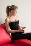Elegant woman in a black cocktail dress Royalty Free Stock Photography