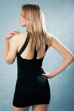 Elegant  woman in black dress Stock Photos