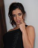 Elegant woman in black dress Stock Photography