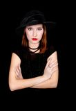 Elegant woman in black dress and hat Stock Images