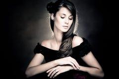 elegant woman in black dress portrait Stock Image