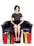 Elegant woman in black dress with shopping bags. Royalty Free Stock Photos